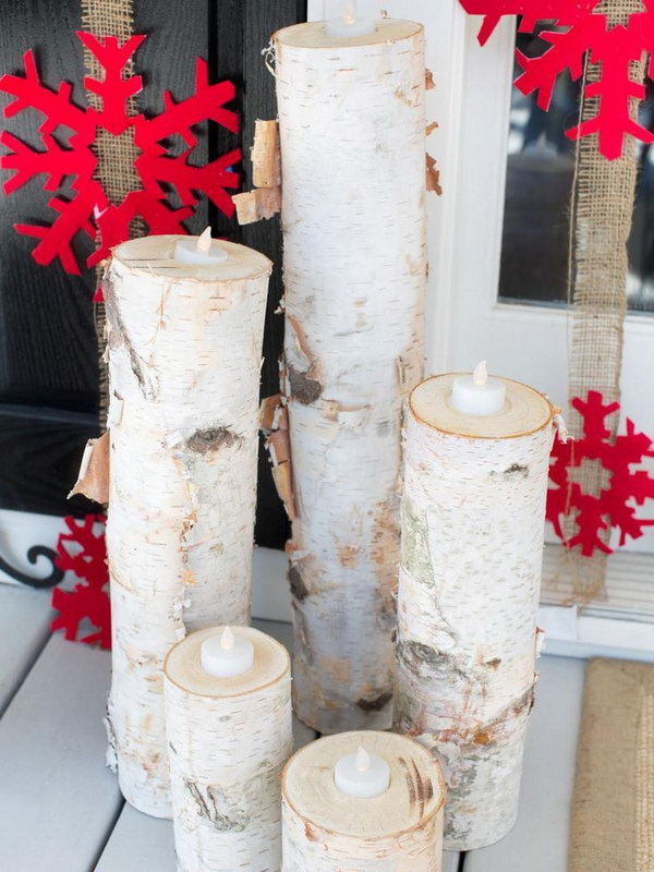 Wooden Christmas Candles with Red Snowflakes. These rustic white Christmas candles made with reclaimed wood are great to display on tabletop, mantle or porch. Another simple rustic and primitive DIY decorartion idea for you Christmas.
