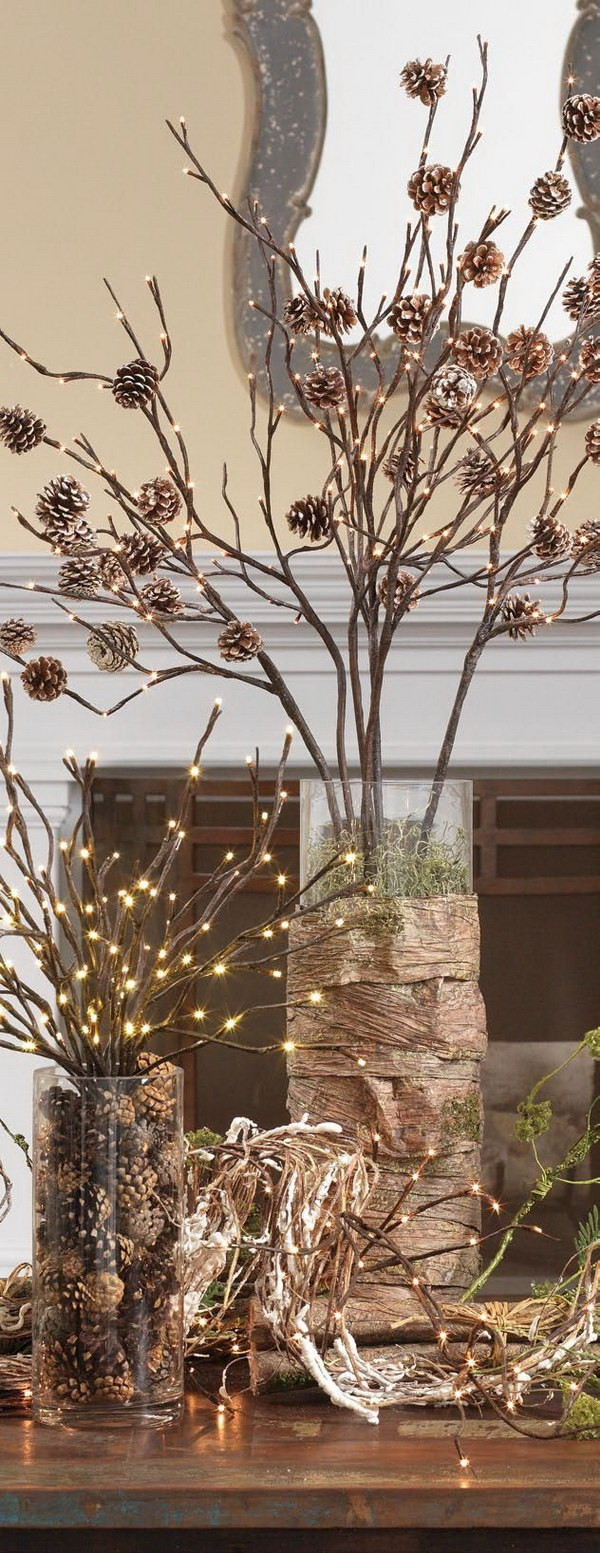 Lighted Pinecone Branch Centerpiece. Arrange this awesome lighted pine cones and branches centerpiece gfor your Christmas table decoration!