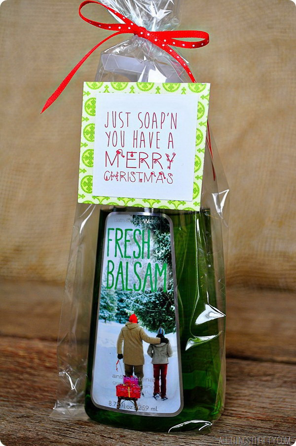 "Bath and Body Works Soap. Homemade bath products always make the perfect giving gifts for everyone around you. This bath and body works soap wrapped with the fun saying, ""Just soap'n you have a Merry Christmas"" makes a super fast and cute Christmas gift!"