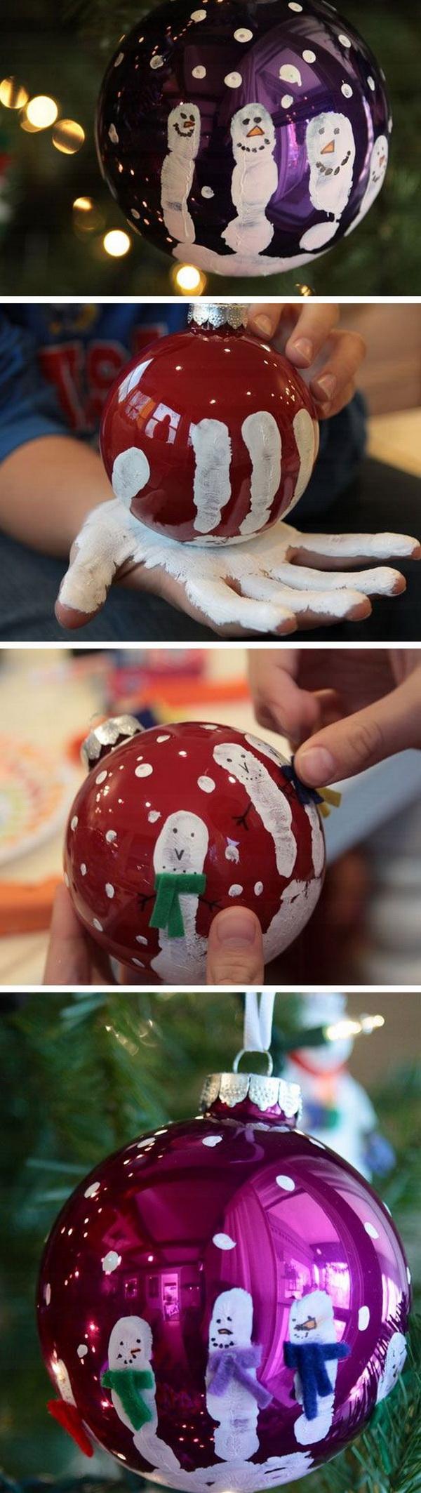 Handprint Christmas Ornaments. Create some cute handprint Christmas tree ornaments using green sparkly salt dough and paints!