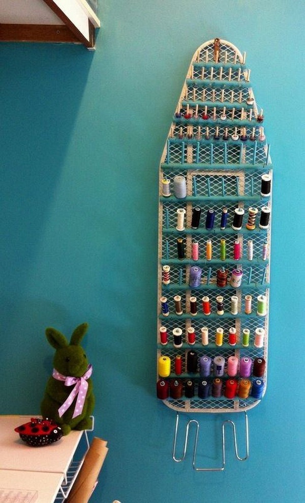 Repurposed Ironing Board For Thread Storage. Never throw away the old ironing board! You can repurpose it for a unique place for your spools of thread in your craft room!