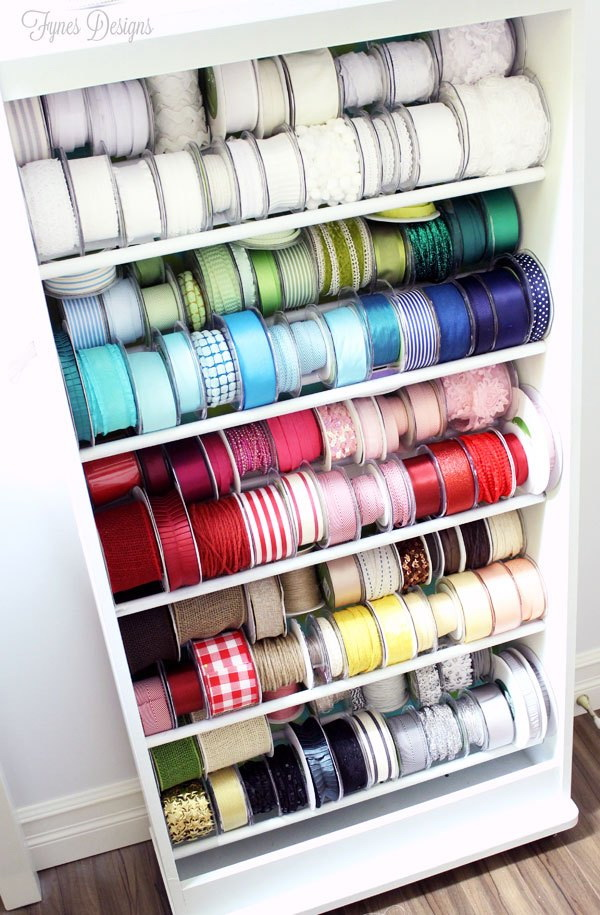 Recycled Ribbon Storage Rack. Turn an old movie stand into this practial and beautiful ribbon storage rack for your craft room. What a wonderful way to easily keep your ribbons organized and easy to access on a budget!