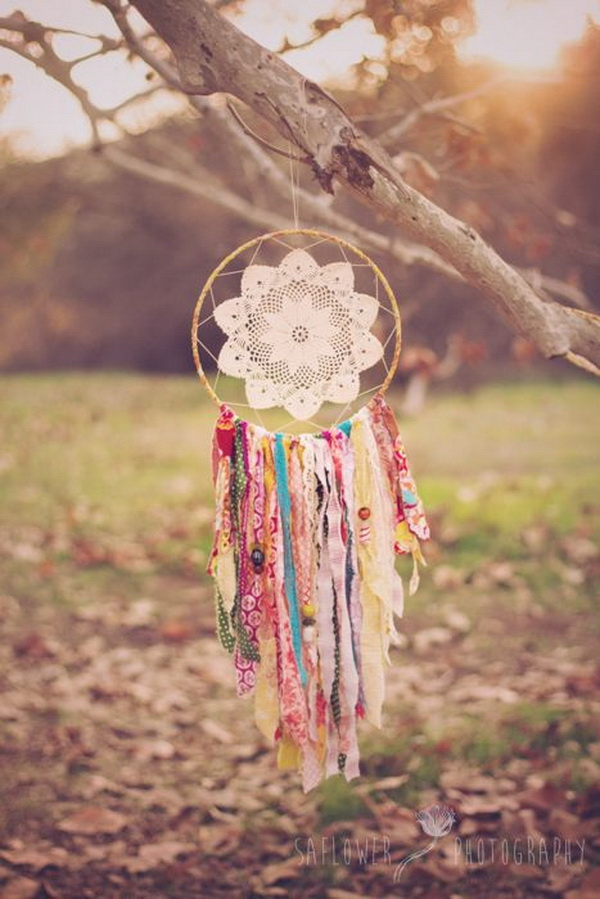 Fabric scraps dreacatcher. This dream catcher looks so delicate with the bright scrap-busting fabric and the easy lace in the center.