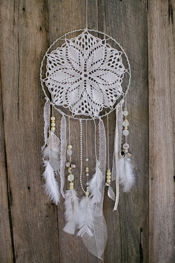 White Doily and Lace Dream Catcher. The floral and crocheted design in the center of this one helps a lot for a vintage-feminine charm!