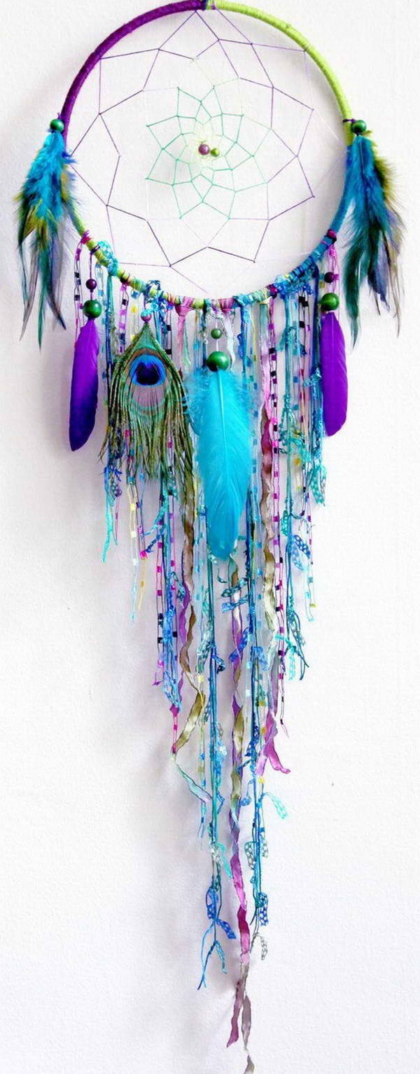 DIY Blue Feather and Bead Dream Catcher. This dream catcher is an attractive one made with blue purple ribbons and feathers. It not only catches a dream for a good night's sleep, but certainly does wonders to your decor.