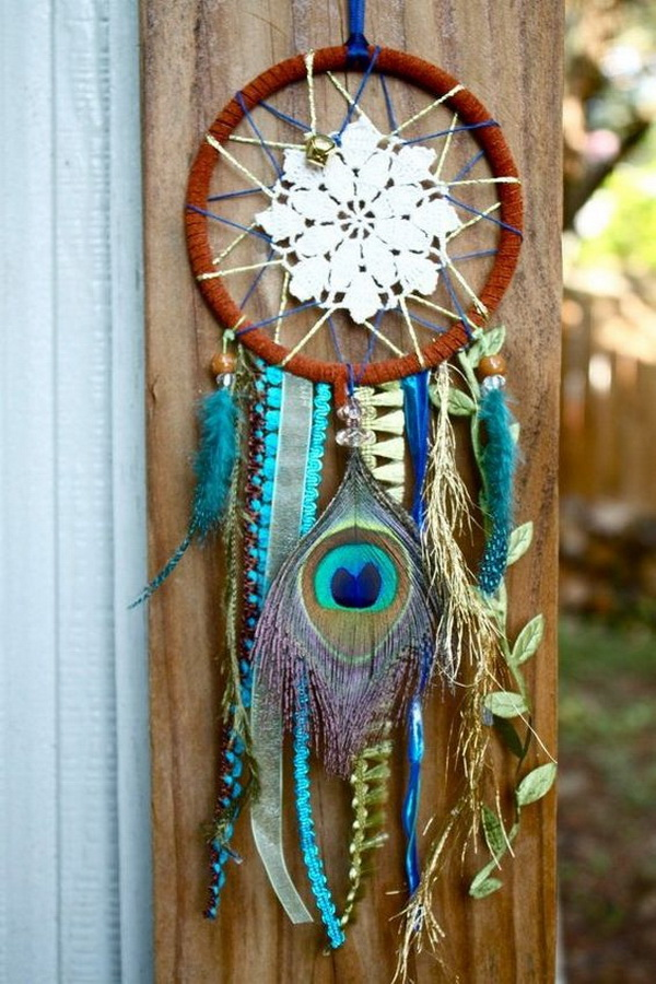 Peacock feather dream catcher.