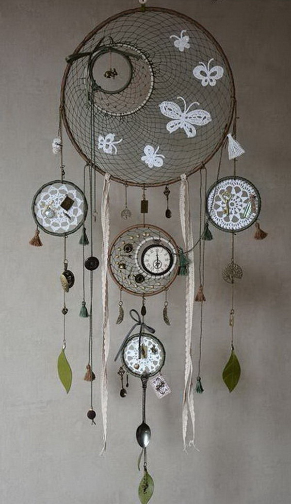 Another intricate dream catcher. An audacious experiment with the design and use clocks, spoons, keys and other vintage pieces for decor.