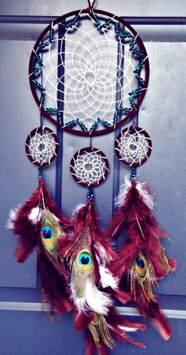 DIY Peacock Dreamcatcher. This dreamcatcher looks so different and unique with the peacock feathers and the red colors. This is great to either make for yourself or as a gift for a family member.