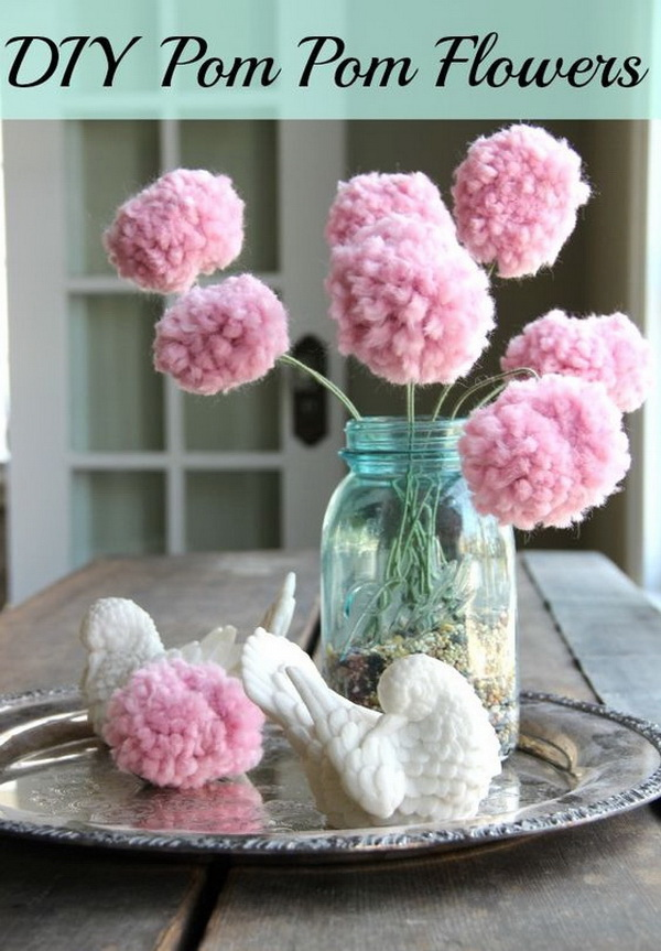 Pom Poms Flowers. Pom poms are fluffy balls made out of varying material, usually paper or fabric. It is very popular for decorating rooms for baby showers or weddings. You can choose to make some with your favorite colors and giving texture and color to your decor. Soft pink pom pom balls on a stick and arranged in a mason jar for a great handmade centerpiece!