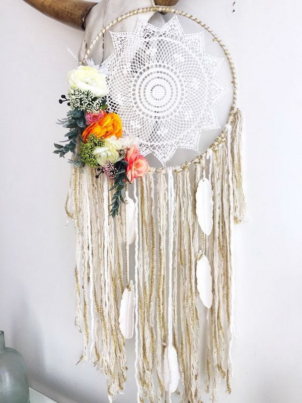 Handmade Dreamcatcher. White, cream, ivory, gold accent color, the perfect bold and neutral color combination! Decorate with assorted colorful fabric and yarn hang from the bottom as well as white and ivory feathers.