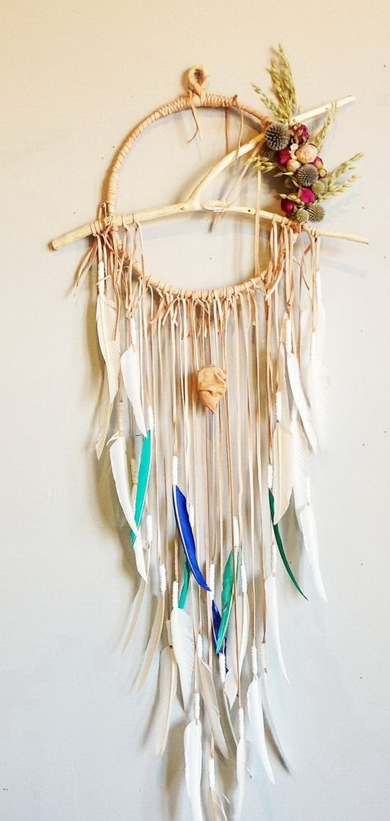 Hand painted feathers dream catcher. The loop in the middle is made from a rustic twig and the lower part is made from new hand painted feathers. Love its farmhouse and seaside charm!