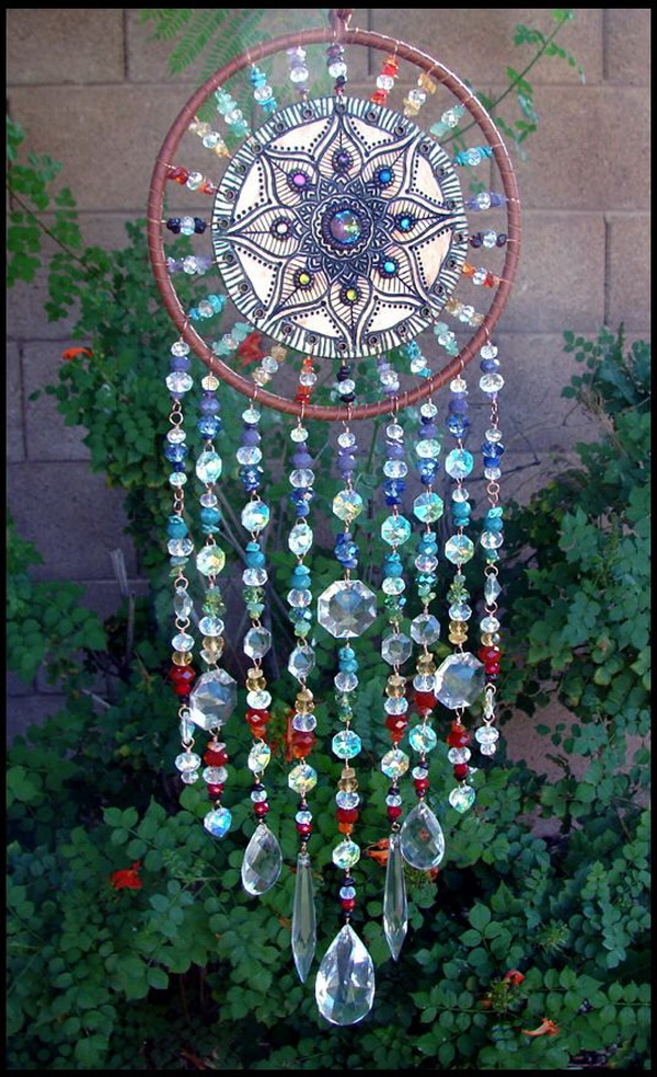 Whimsical Crystals Dream Catcher. This is a great to use up all leafover crystals lying around your dresser. A handpainted mandala piece in the center with crystals surrounded.