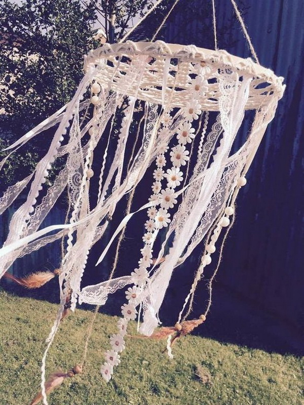 Doily Dream Catcher Mobile. The lacy and floral ribbons are great for feminine and girlish charm.