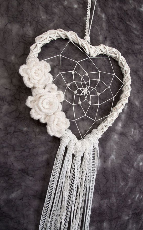 White Heart Dream Catcher wedding decor. Instead of regular circle loops, this one is designed with a heart loop and decorated with crochet flowers. Perfect as a wall hanger or wedding decor!