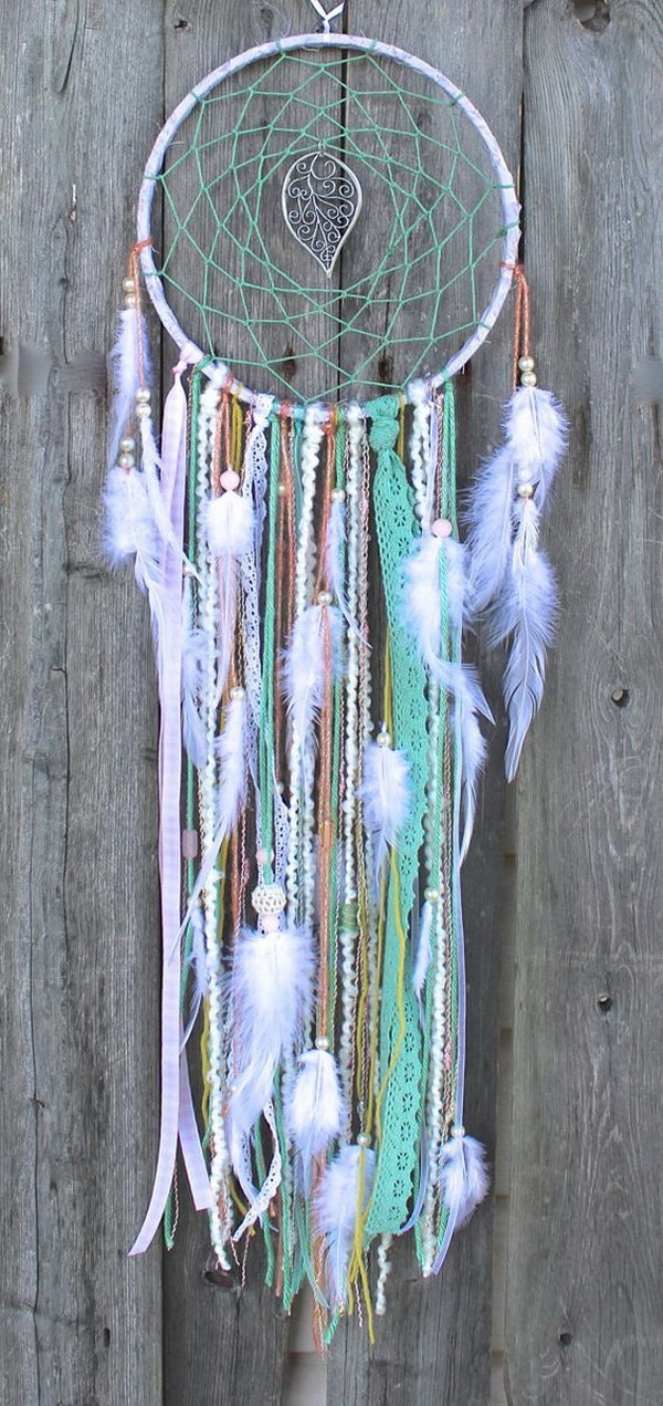 Simple crocheted web is woven to catch bad dreams and allow good dreams to pass through the center. Beads, soft feathers and different colored strings, lacy ribbons...love the soft and peacefull looking of this one!