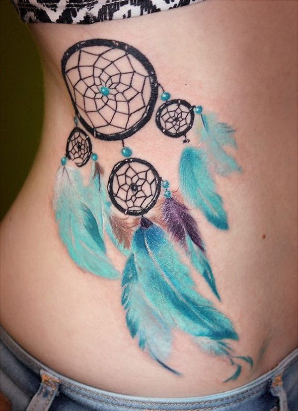 Dream catcher tattoo design with soft ice blue feathers.