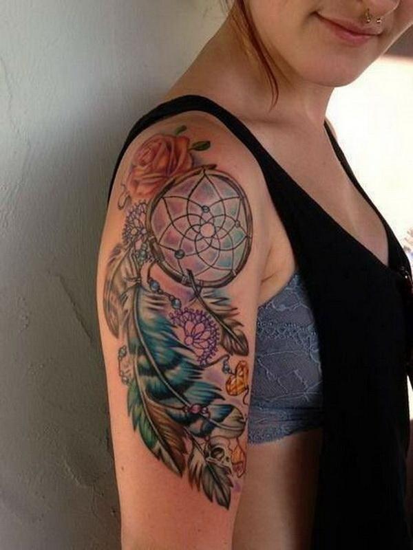 Colorful arm dream catcher tattoo.