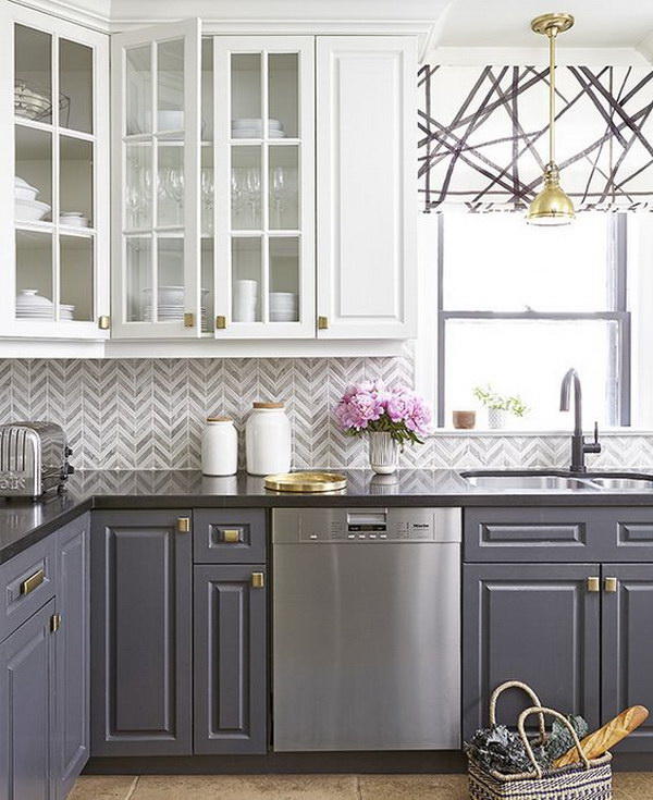 Grey And White Chevron Tile Backsplash With Two Tone Cabinets.