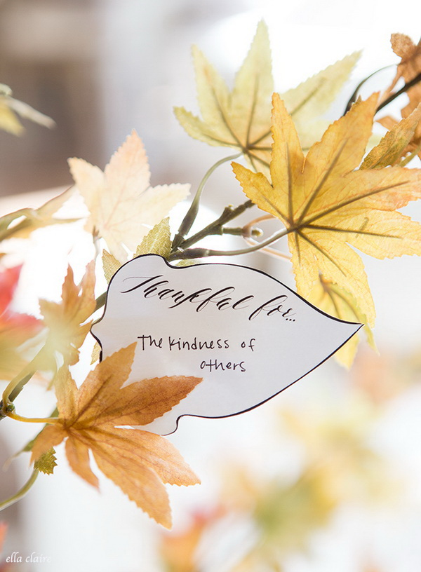 Thankful Tree Leaves Decor with Tags. You write what you are thankful for on the fall leaves and attach them to branches. This is a great and creative way to say thanks for the Thanksgiving Day. And these thankful fall leaf garland definitely adds some natural elements to your home decor.