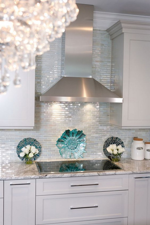 Iridescent glass tile. Stainless hood with taupe cabinets. Color looks good.