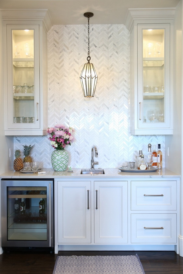 Multicolored chevron patterned tile backsplash. Love the tile backsplash in 3 different glaze colors and small chevron shape.