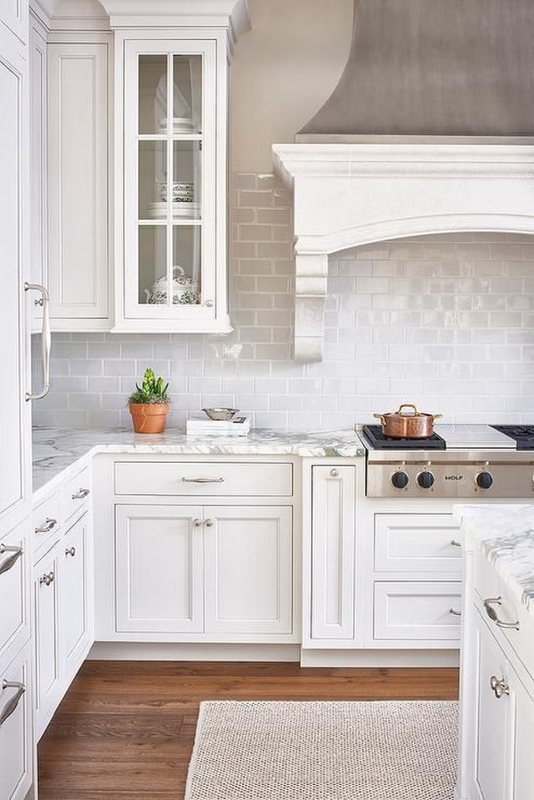 White subway tile backsplash with cream border.