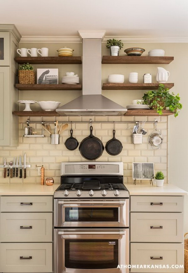 Beige Subway Tile Backsplash with border. The rustic wooden open Shelvings around range hood looks so perfect with the beige tile backsplash. It offers the warm and rustic charm for this farmhouse kitchen.