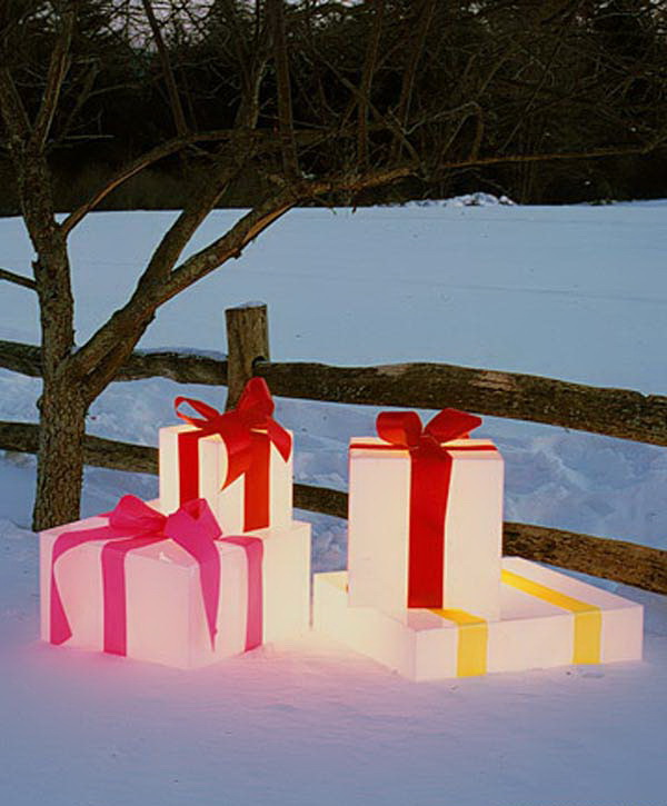 Glowing Gift Boxes. Make illuminated gift boxes for outdoor decor using plastic boxes and waterproof ribbon. Add string lights or battery operated bulbs inside. It offers much more holiday cheer to any outside decor this holiday season.