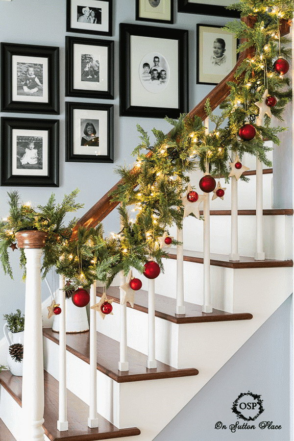 DIY Glowing Garland for Stairway Banister Decoration. Be crafty to add some Chirstmas lights and ornaments to the evergreen galand, the result turns out so festive for your decoration! It is perfect for the stairway banister decoration!