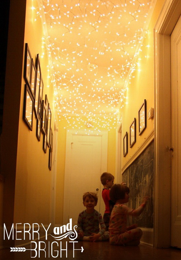 DIY Lighted Ceiling. Add twinkle lights to your hallway ceiling! All things looks so MERRY & BRIGHT! This will be a wonderful idea for kids playroom or living room's decoration as well.
