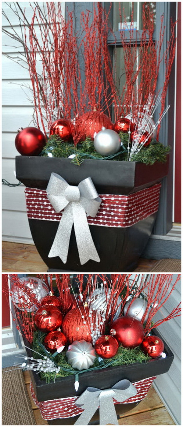 Christmas Outside Planter for Front Porch. Use a big flower pots as a base, and fill them with evergreen garland, huge ornaments, sparkly twigs and white lights!  A package full of sparkle! They look very pretty all lit up at night too!