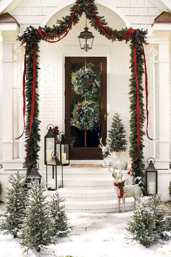 Christmas Greenery and Ribbon Entry. Decorate your front porch with rope garland, red ribbon, lanterns, and a few reindeer for an unexpected surprise! This will give your guests a big surprise during the Chirstmas seson!