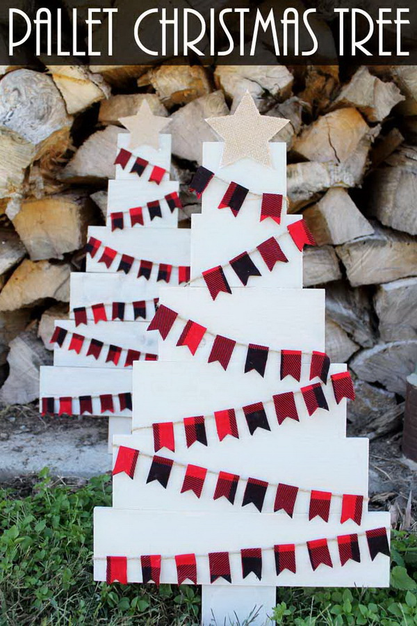 DIY Wood Pallet Christmas Tree. Turn the wood pallets into Christmas tree and decorate with some pieces of buntings and star toppers! Perfect and festive for indoor or outdoor display this holiday season!