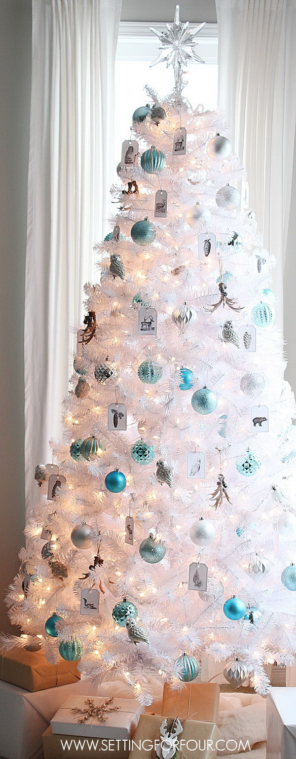 white christmas tree with silver and blue ornaments love the simple clear and chic