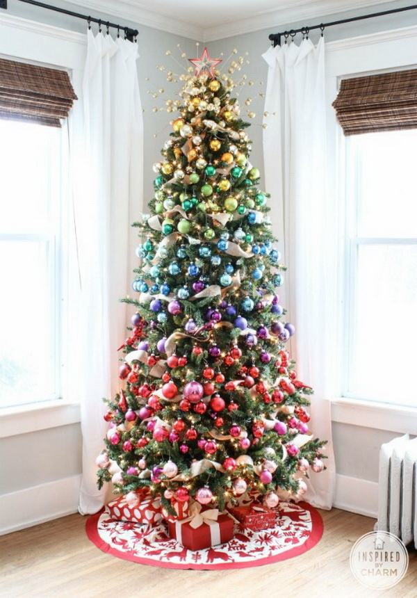 Tradional Green Chirstmas tree decorated with ombre rainbow ornaments.