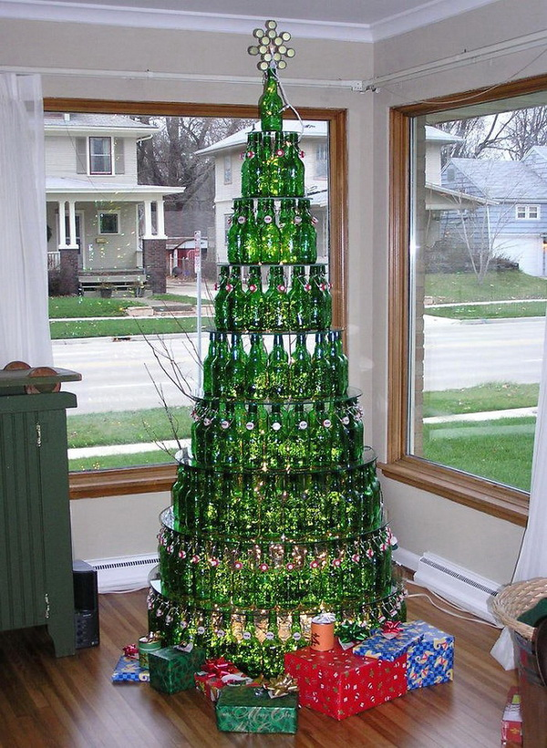 Wine bottles stacked Christmas tree. Many people transform a handful of empty glass bottles into a set of sparkling holiday decorations.