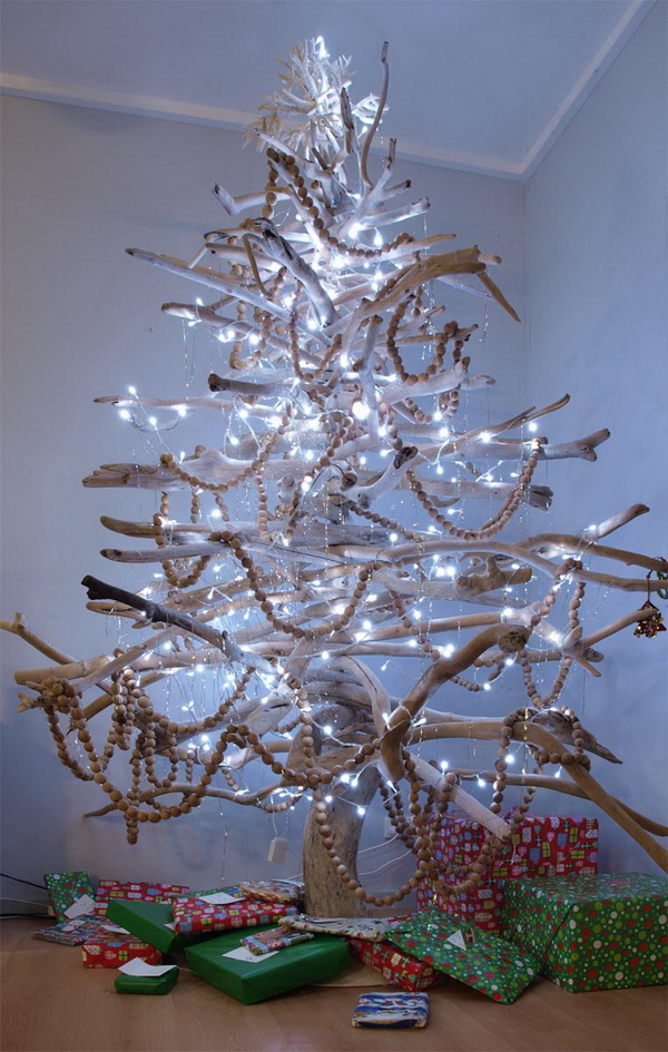 Branches Chirstmas tree. Create a Christmas tree with rustic branches and add more stringed holiday lights. Love the modern and natural look of the amazing holiday centerpiece!
