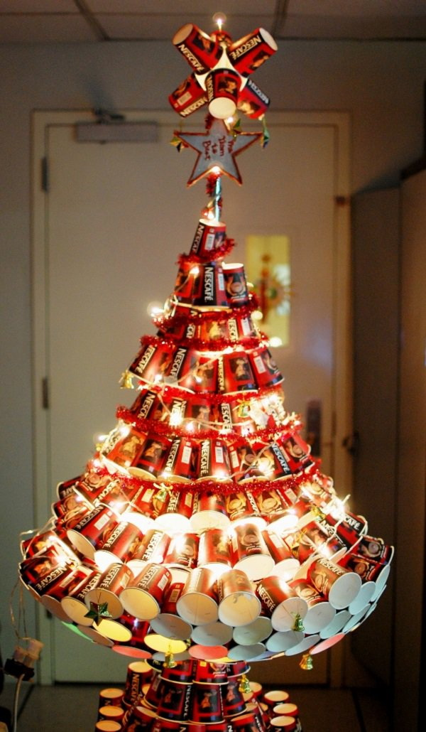 Creative Christmas Tree Made with Coffee Cups. If you are a coffee lover and love collecting the coffee cups, here is a creative way to recycle all those cups and arrange them to form into a Christmas tree and add some Christmas lighting inside. This is a stunning DIY project for Christmas decoration!