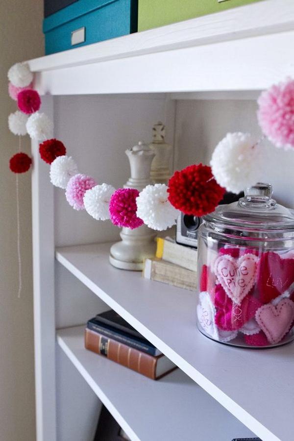 Super cute yarn pom pom garland! Fun for Valentine's Day!