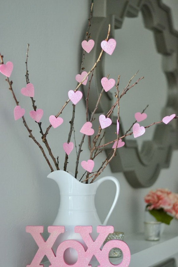 Easy DIY Heart Tree. Decorating for Valentine's Day is a great way to bring good mood to your life. This little heart tree looks so elegant for your Valentine's Day Mantel decoration and it only cost you $1 to make!
