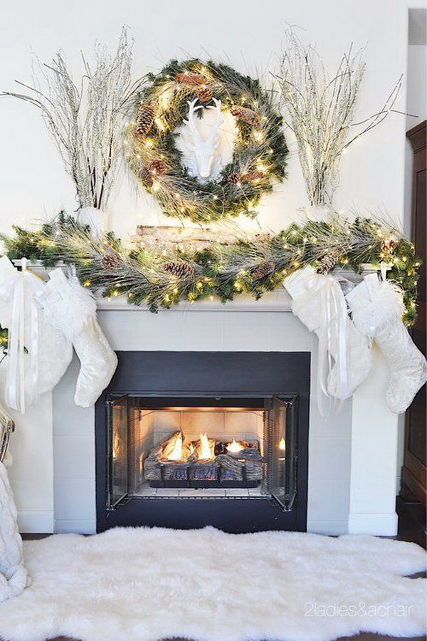 Dreamy Christmas Mantel Decor with Twinkling Lights and Greenary.