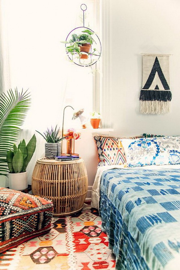 Bohemian style guest room with bold and aztec inspired patterns.