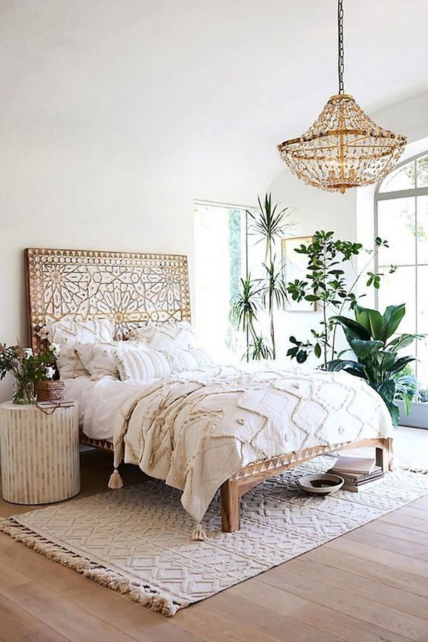 Bohemian bedroom with creamy white accents.