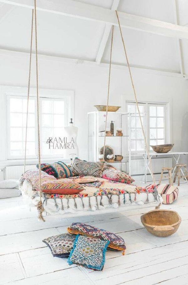 Boho inspired living room wit a hammock.