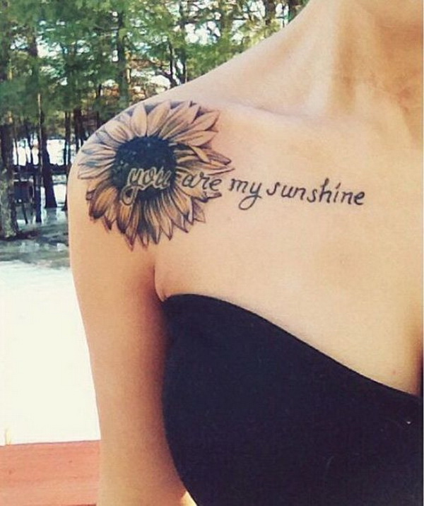 "Sunflower Shoulder Tattoo with the script ""You are my sunshine""."