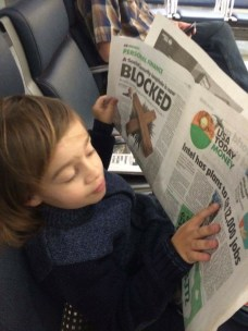 Judah practicing his phonics with the business section