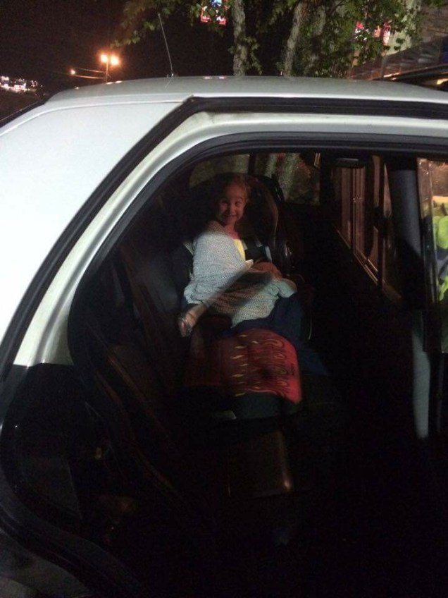 Anna's first, hopefully last, time in a police car after our blow out