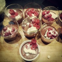 Chocolate mousse with raspberries and vanilla cream