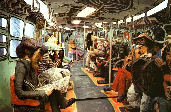 lively lifesize puppets occupy every seat in what appears to be the interior of a subway car