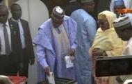 Buhari, Aisha Vote In Daura, Atiku, Titi In Yola